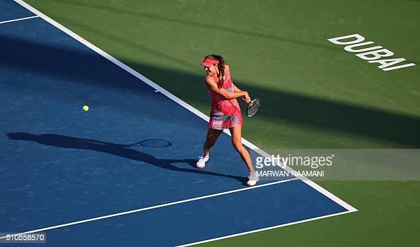 Serbian tennis player Ana Ivanovic returns the ball to Australian player Daria Gavrilova during the first round of the WTA Dubai Open tennis...