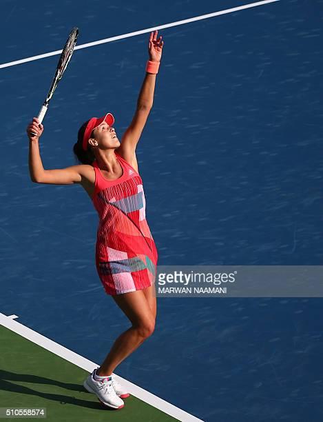 Serbian tennis player Ana Ivanovic serves the ball to Australian player Daria Gavrilova during the first round of the WTA Dubai Open tennis...