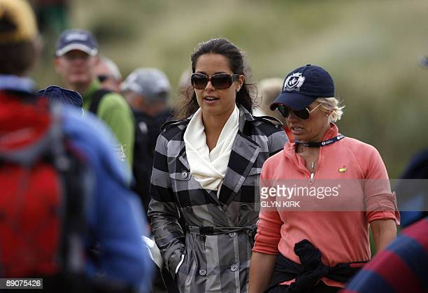 Serbian tennis player Ana Ivanovic watches her patner Australian golfer Adam Scott on the 7th fairway on the second day of the 138th British Open...