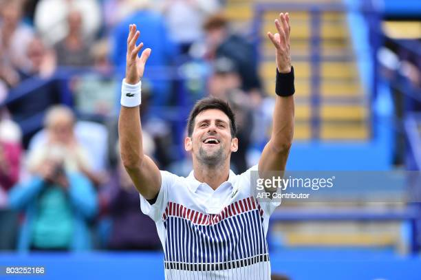 Serbian tennis player and world number four Novak Djokovic reacts after winning against Donald Young of the US during their men's singles quarter...