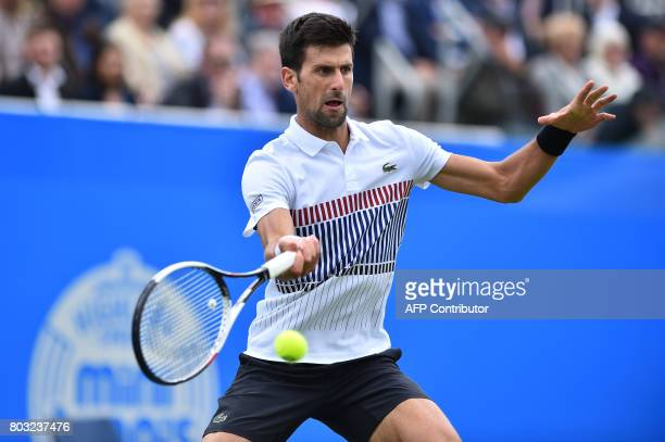 Serbian tennis player and world number four Novak Djokovic returns to Donald Young of the US during their men's singles quarter final tennis match at...