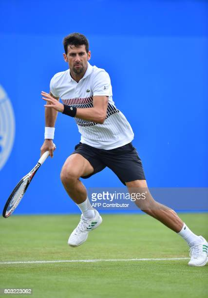 Serbian tennis player and world number four Novak Djokovic runs during his men's singles quarter final tennis match against Donald Young of the US at...