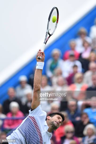 Serbian tennis player and world number four Novak Djokovic serves to Donald Young of the US during their men's singles quarter final tennis match at...