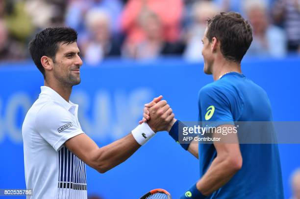 Serbian tennis player and world number four Novak Djokovic shakes hands with Canadian Vasek Pospisil after their men's singles round two tennis match...