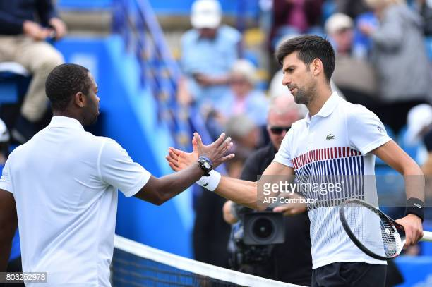 Serbian tennis player and world number four Novak Djokovic shakes hands with Donald Young of the US after winning their men's singles quarter final...