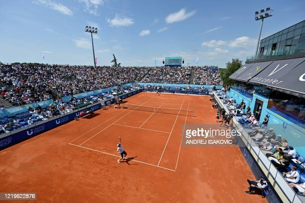 Serbian tennis player Dusan Lajovic serves the ball against Bulgarian tennis player Grigor Dimitrov during an single match at a charity exhibition...