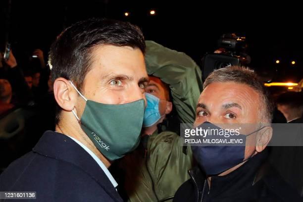 Serbian tennis player Novak Djokovic , accompanied by his father Srdjan Djokovic, celebrates 311 weeks as world number one with his family and...