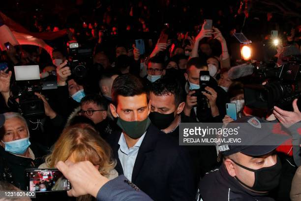Serbian tennis player Novak Djokovic , accompanied by his parents, celebrates 311 weeks as world number one with his family and supporters in front...