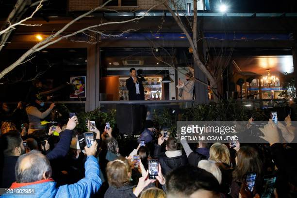 Serbian tennis player Novak Djokovic addresses fans as he celebrates 311 weeks as world number one with his family and supporters in front of family...