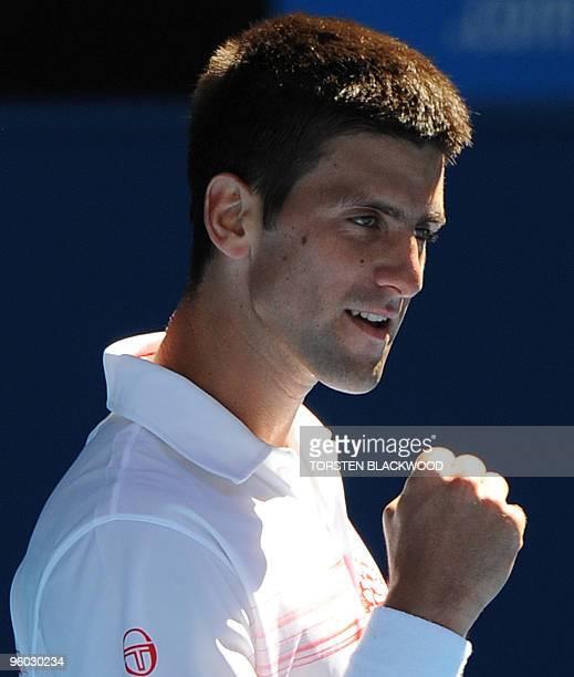 Serbian tennis player Novak Djokovic gestures during his third round men's singles match against Uzbek opponent Denis Istomin at the Australian Open...