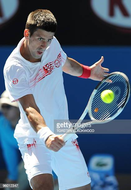 Serbian tennis player Novak Djokovic plays a backhand return during his third round men's singles match against Uzbek opponent Denis Istomin at the...
