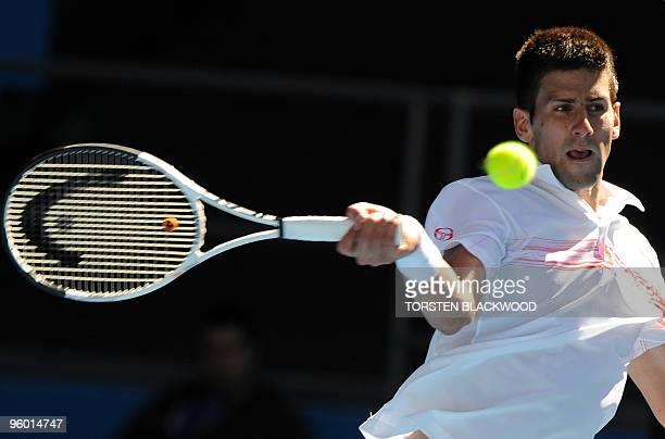 Serbian tennis player Novak Djokovic plays a forehand return during his third round men's singles match against Uzbek opponent Denis Istomin at the...