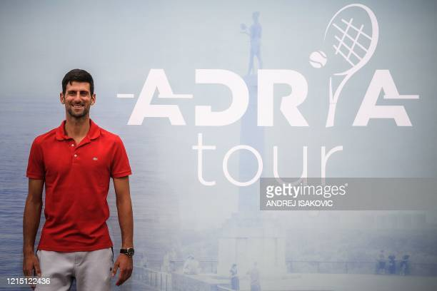 Serbian tennis player Novak Djokovic poses for photographers after a press conference on the upcoming Adria Tour tennis tournament in Belgrade on May...