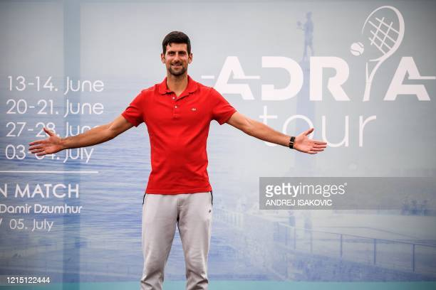 TOPSHOT Serbian tennis player Novak Djokovic poses for photographers after a press conference on the upcoming Adria Tour tennis tournament in...