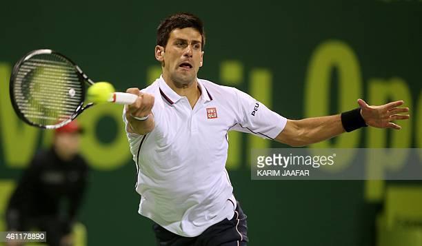 Serbian tennis player Novak Djokovic returns the ball to Ivo Karlovic of Croatia during their quarterfinals tennis match in Qatar's ExxonMobil Open...