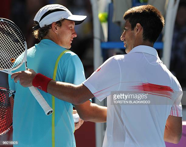 Serbian tennis player Novak Djokovic shakes hand with Uzbek opponent Denis Istomin after victory in his third round men's singles match at the...