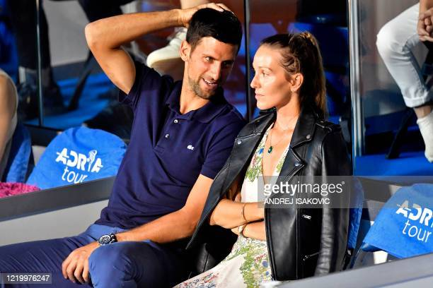 Serbian tennis player Novak Djokovic talks to his wife Jelena during a match at the Adria Tour Novak Djokovic's Balkans charity tennis tournament in...