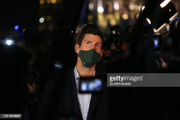 Serbian tennis player Novak Djokovic watches videos of the most important moments of his career projected onto Belgrade's city hall with fans...