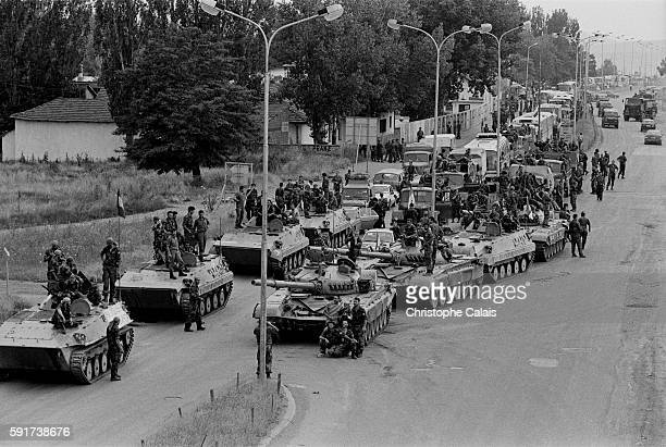 Serbian troops begin their withdrawal from Pristina in the Kosovo area with a deadline imposed by NATO of June 15 1999