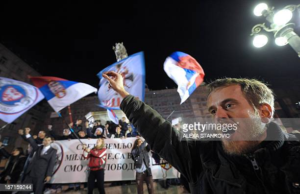 Serbian ultra-nationalist shouts slogans during a rally to protest after a UN court cleared Kosovo's former prime minister Ramush Haradinaj of war...