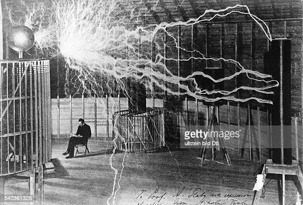 NIKOLA TESLA SerbianAmerican inventor engineer and futurist Nikola Tesla studying electricity in the laboratory circa 1899