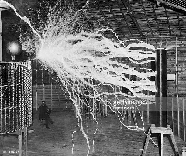 SerbianAmerican inventor engineer and futurist Nikola Tesla studying electricity in the laboratory 1900