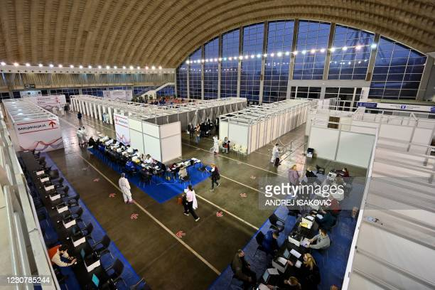 Serbians arrive to receive the Chinese-made Sinopharm Covid-19 vaccine in Belgrade Fair turned into a vaccination centre, on January 25, 2021. -...