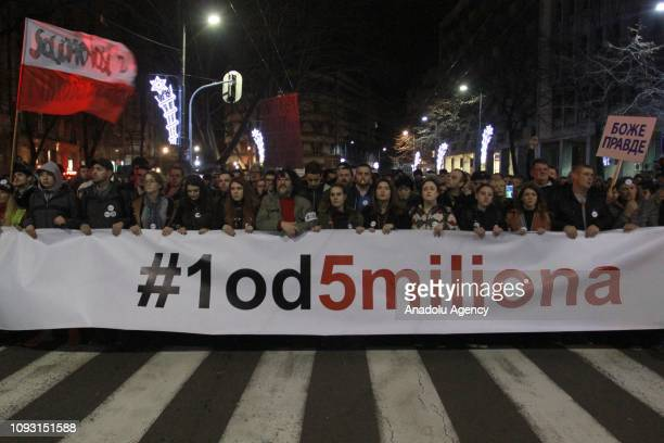 Serbians take part in a protest against the government named as One in five millions as they hold a banner in Belgrade Serbia on February 2 2019