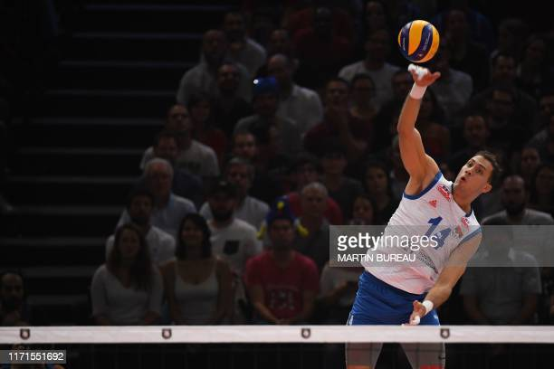 Serbia's Aleksandar Atanasijevic serves against France during the semi final match of the men's 2019 CEV Volleyball European Championship between...