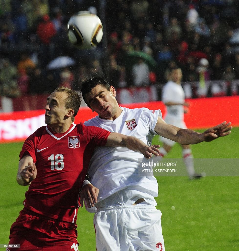 Serbia's Aleksandar Kolarov (R) fights for the ball with Poland's Adrian Mierzejewski (L) during their friendly match between their teams in the local stadium of Kufstein on June 2, 2010 prior to the FIFA World Cup 2010 hosted by South Africa between June 11 and July 11.