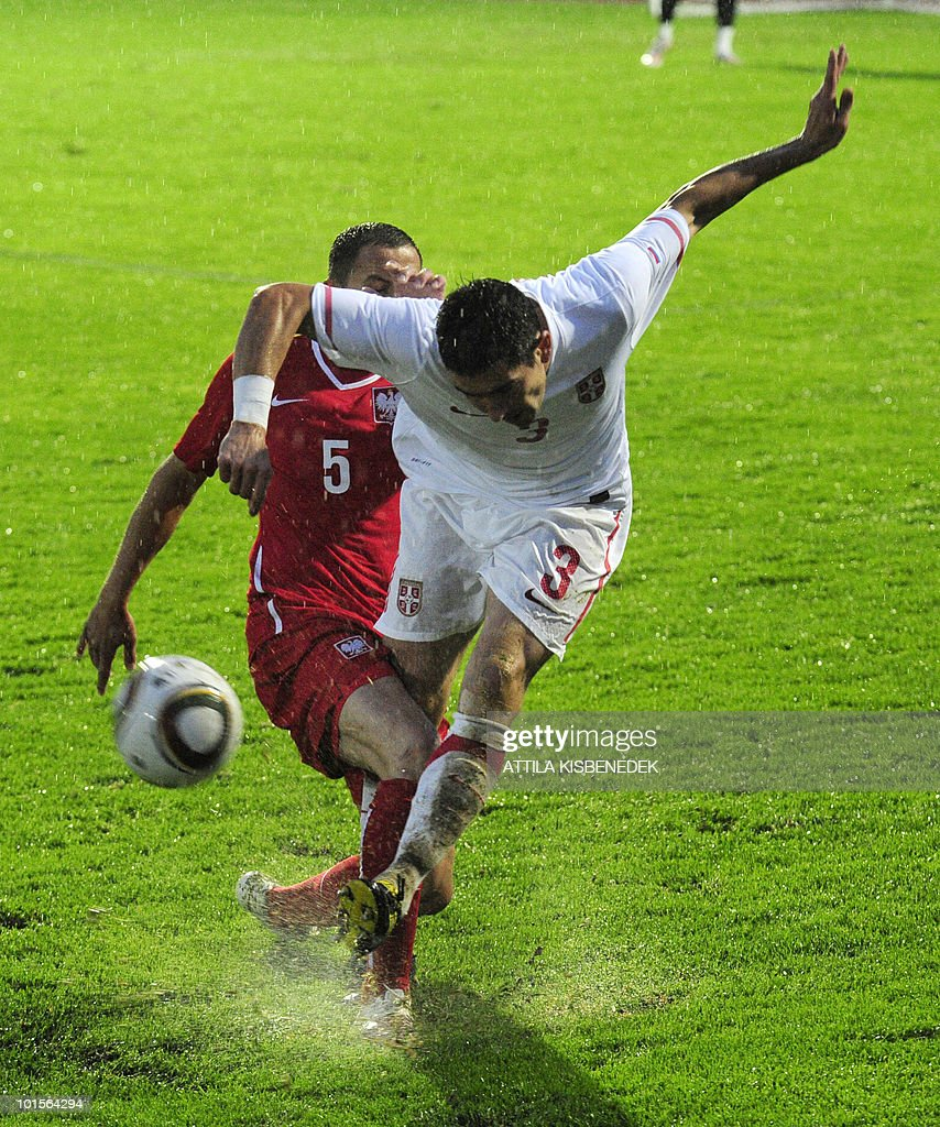 Serbia's Aleksandar Kolarov (R) fights for the ball with Poland's Dariusz Dudka (L) during their friendly match in the local stadium of Kufstein on June 2, 2010 prior to the FIFA World Cup 2010 hosted by South Africa between June 11 and July 11.