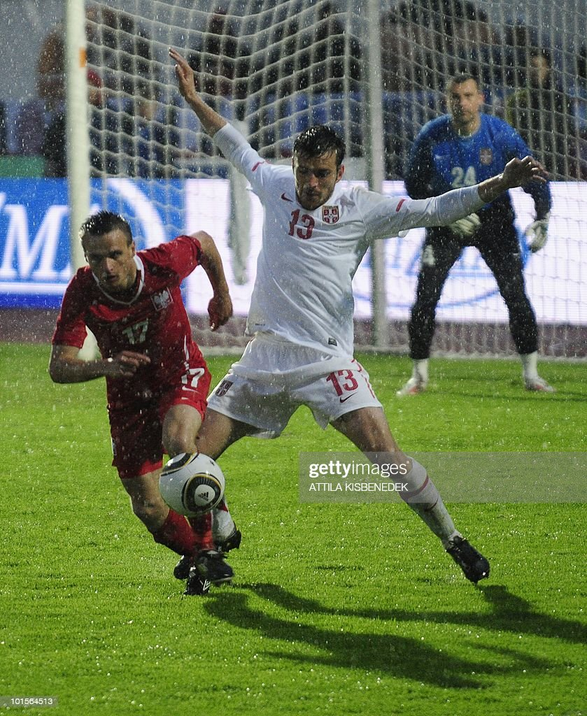 Serbia's Aleksandar Lukovic (R) fights for the ball with Poland's Skawomir Peszko (L) during their friendly match in the local stadium of Kufstein on June 2, 2010 prior to the FIFA World Cup 2010 hosted by South Africa between June 11 and July 11.