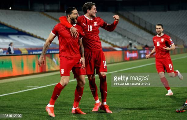 Serbia's Aleksandar Mitrovic celebrates his goal with Dusan Vlahovic during the FIFA World Cup Qatar 2022 qualification football match between Serbia...