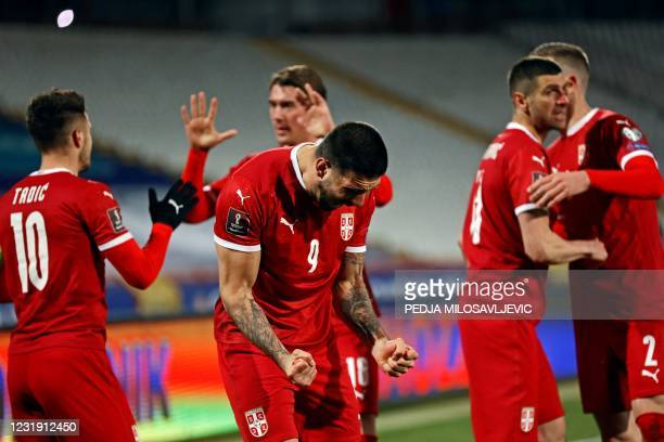 Serbia's Aleksandar Mitrovic celebrates his goal with teammates during the FIFA World Cup Qatar 2022 qualification football match between Serbia and...