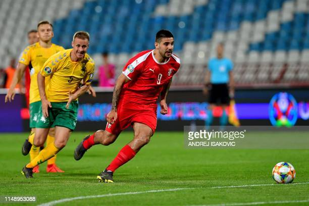 Serbia's Aleksandar Mitrovic controls the ball in front of Lithuania's Algis Jankauska during the Euro 2020 football qualification match between...