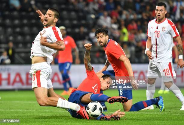 Serbia's Aleksandar Mitrovic is fouled by Chile's Erick Pulgar during the international friendly football match Serbia v Chile at the Merkur Arena in...