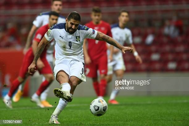Serbia's Aleksandar Mitrovic kicks a penalty kick and scores second goal during the UEFA Nations LeagueB, group G football match between Turkey and...