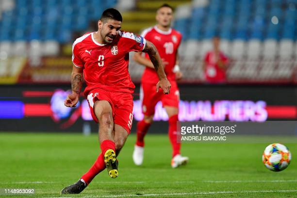 "Serbia's Aleksandar Mitrovic kicks the ball during the Euro 2020 football qualification match between Serbia and Lithuania at the ""Rajko Mitic""..."