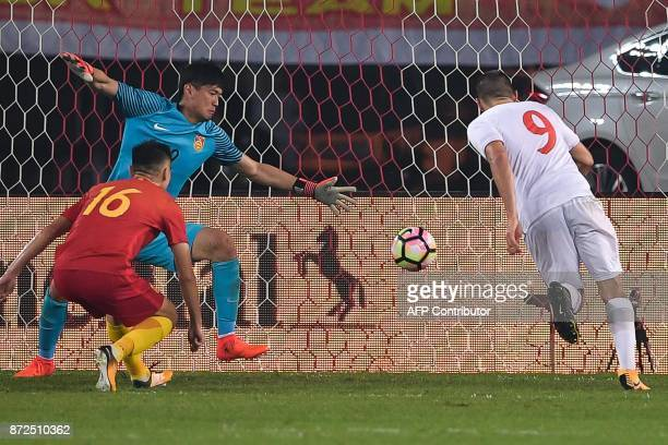 Serbia's Aleksandar Mitrovic takes a shot at goal during an international friendly football match against China National Team at Tianhe Sports Centre...