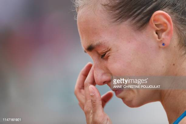 Serbia's Aleksandra Krunic reacts after loosing against Ukraine's Lesia Tsurenko at the end women's singles third round match on day six of The...