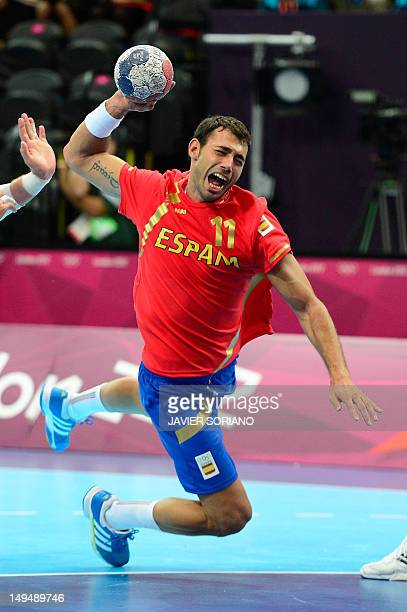 Serbia's Alem Toskic jumps to shoot during the men's preliminaries Group B handball match Spain vs Serbia for the London 2012 Olympics Games on July...