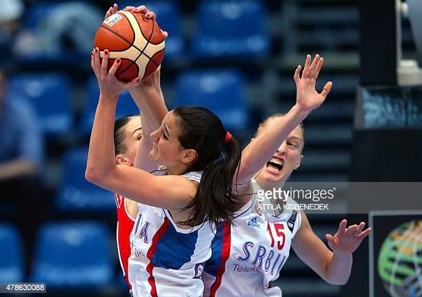 Serbia's Ana Dabovic and Danielle Page vies for the ball with Balarus's Anastasiya Verameyenka during a semi final basketball match between Serbia...
