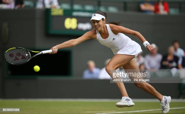 Serbia's Ana Ivanovic in action against Germany's Sabine Lisicki during day eight of the Wimbledon Championships at the All England Lawn Tennis and...