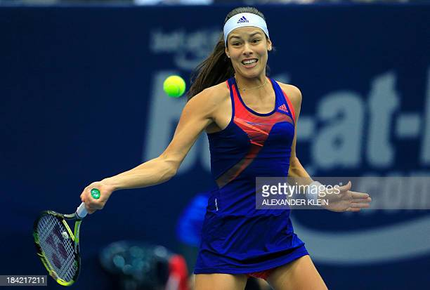 Serbia's Ana Ivanovic returns the ball to Switzerland's Stefanie Voegele during their semi final match of the WTA tennis tournament in Linz on...