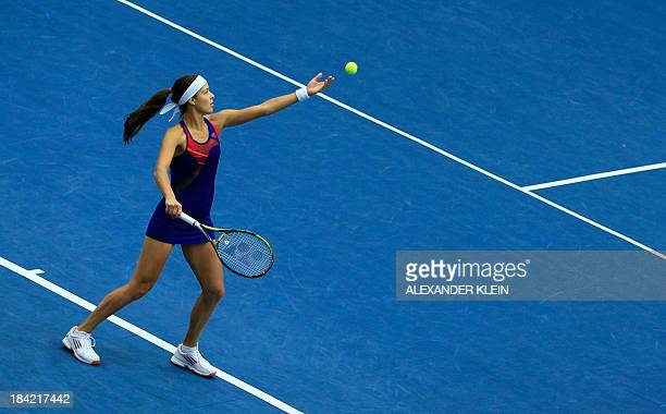 Serbia's Ana Ivanovic serves the ball to Switzerland's Stefanie Voegele during their semi final match of the WTA tennis tournament in Linz on October...