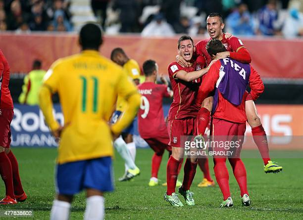Serbia's Andrija Zivkovic and Milan Gajic celebrate during the FIFA Under20 World Cup football final match between Brazil and Serbia in Auckland on...
