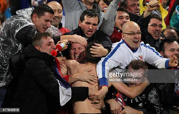 Serbia's Andrija Zivkovic celebrates with fans after the FIFA Under20 World Cup football final match between Brazil and Serbia in Auckland on June 20...