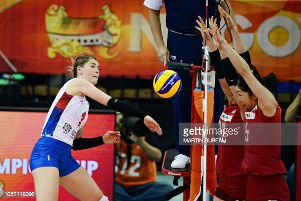 Serbia's Bianka Busa spikes the ball during the 2018 FIVB World Championship volleyball women's pool G match between Japan and Serbia in Nagoya on...