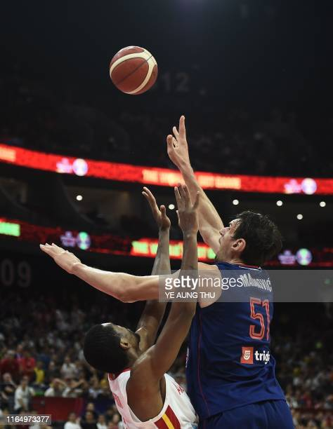 Serbia's Boban Marjanovic reaches for the ball during the Basketball World Cup Group D game between Angola and Serbia in Foshan on August 31, 2019.