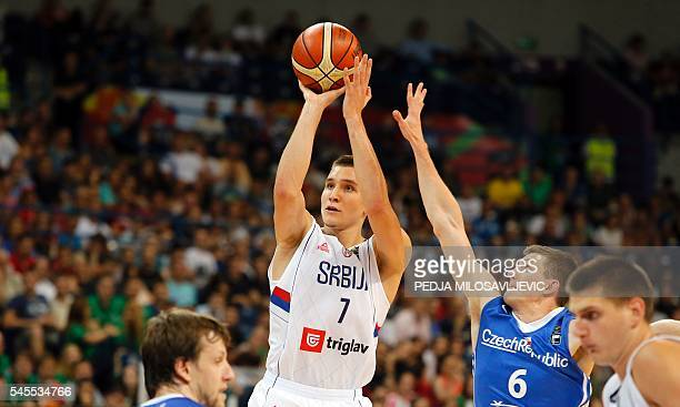 Serbia's Bogdan Bogdanovic scores a point in front of Czech Republic's Pavel Pumprla during the 2016 FIBA World Olympic Qualifying semi final...